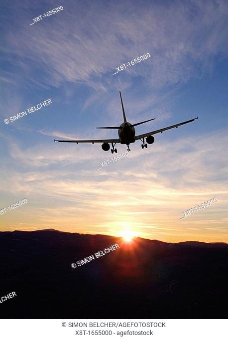 Airplane Taking Off into a Sunset