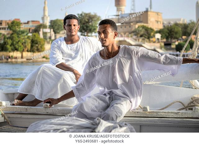 Egyptian sailing men, sailing a traditional felucca in Aswan, Egypt, Africa