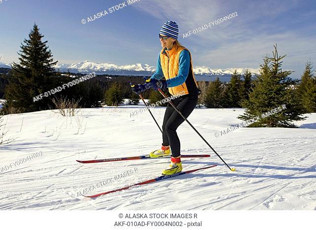 Woman nordic sking at Baycrest ski trails Homer Alaska Kenai Peninsula