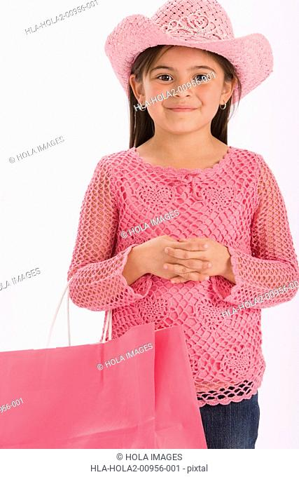 Young girl wearing pink cowgirl hat
