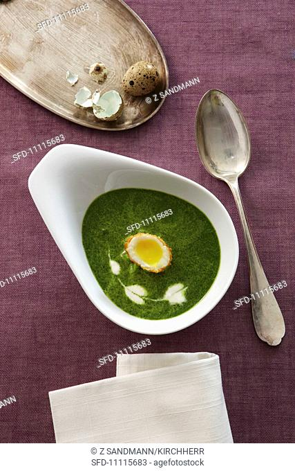 Watercress soup with fried quail's eggs