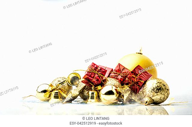Red gift boxes and golden christmas balls over white background