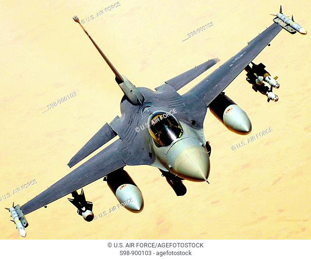 A U S  Air Force F-16 Fighting Falcon aircraft returns to the fight after receiving fuel June 10, 2008 from a KC-135 Stratotanker during a mission over Iraq...