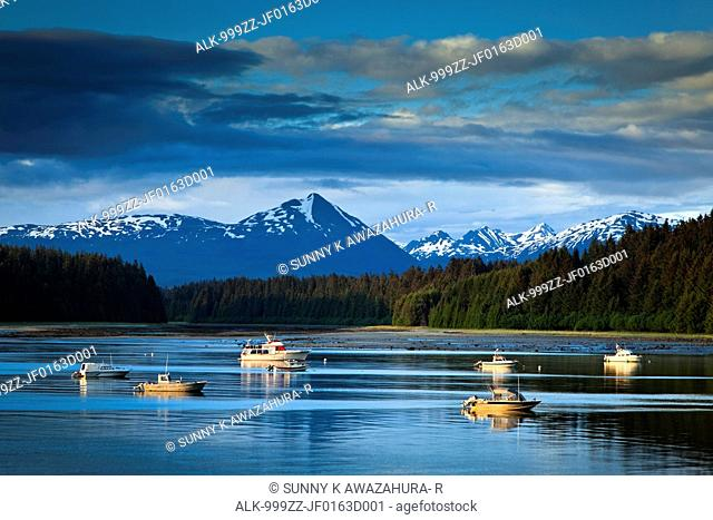 Scenic evening view of Bartlett Cove and moored fishing boats, Glacier Bay National Park & Preserve, Southeast Alaska, Summer