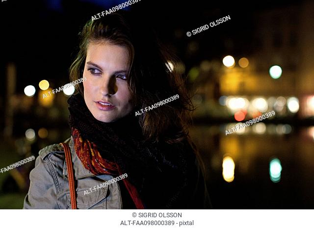 Woman outdoors at night, portrait