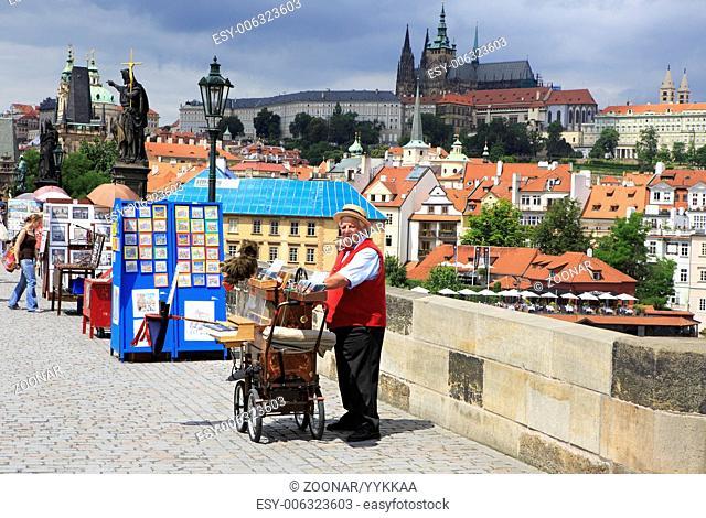 Organ grinder on the Charles Bridge in Prague