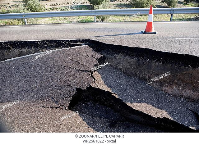 Asphalt road with a crack caused by landslides, Jaén, Andalusia, Spain