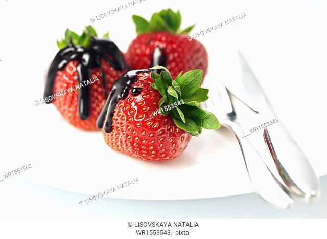Strawberries in chocolate on white background