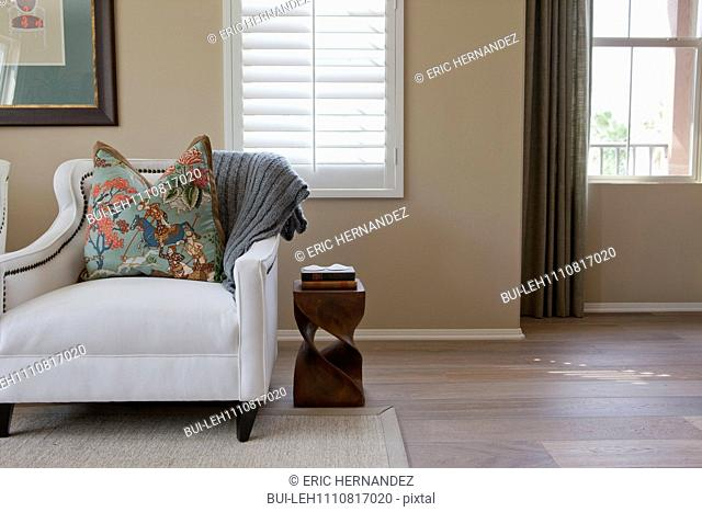 Cushion on armchair in the living room at home; Irvine; California; USA