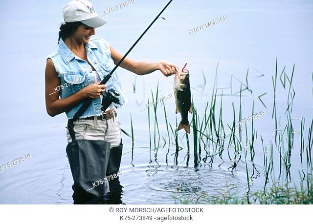 Woman catches fish