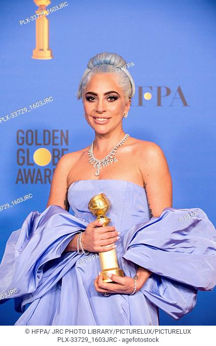 """After winning the category of BEST ORIGINAL SONG – MOTION PICTURE for """"""""Shallow"""""""" from """"A Star Is Born"""", Lady Gaga poses with the award backstage in the press..."""