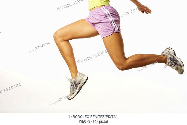 Woman running in a studio setting