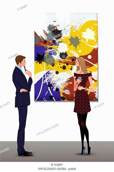 Young Couple Viewing Art Hung On The Wall In A Gallery