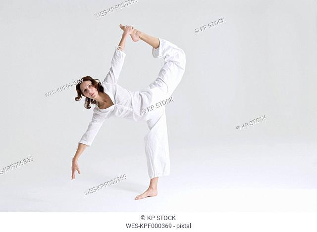 Mid adult woman doing exercise