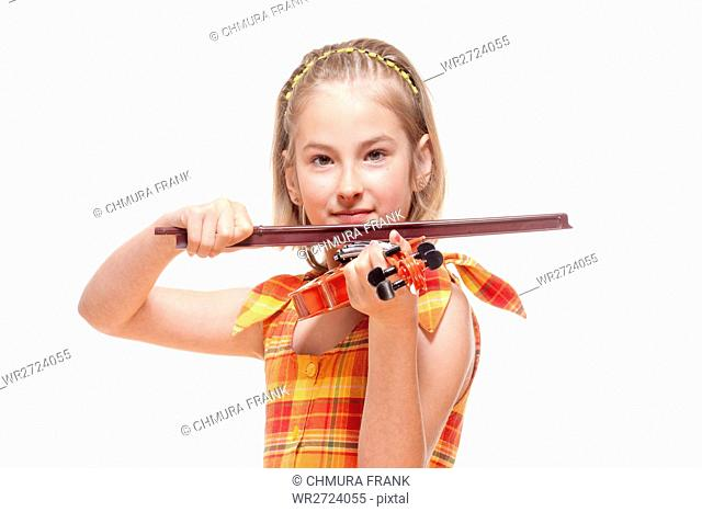 Portrait of a Little Girl Playing Toy Violin - Isolated on White