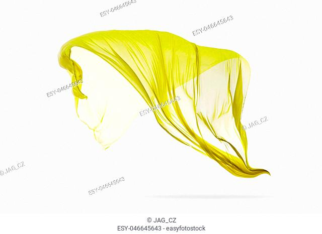 Smooth elegant yellow transparent cloth separated on white background. Texture of flying fabric. Very high resolution image