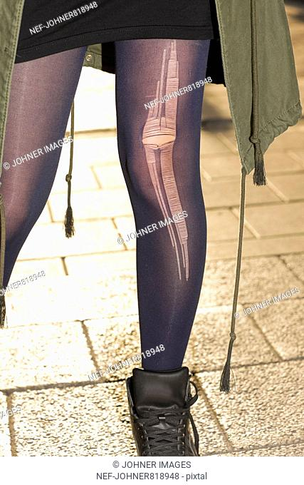 Teenage girl with torn pantyhose, Sweden