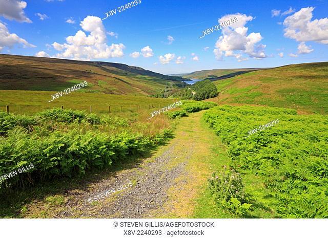 Trans Pennine Trail and distant Woodhead Reservoir, Longdendale, Derbyshire, Peak District National Park, England, UK