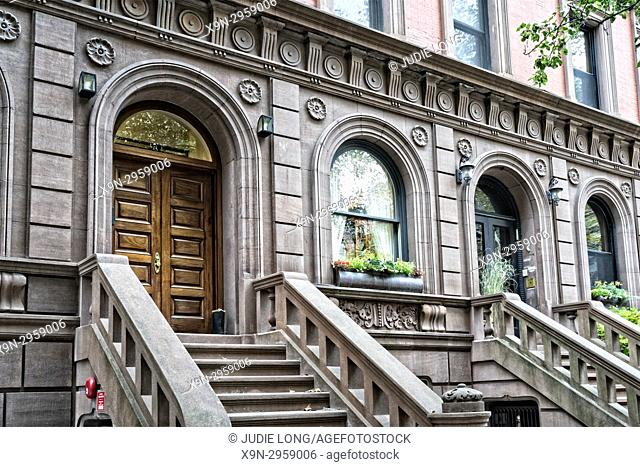 New York City Manhattan, Upper West Side. Looking Up at the Entrances to Two Brownstone Townhouses, With Distinctively Upper West Side Architecture