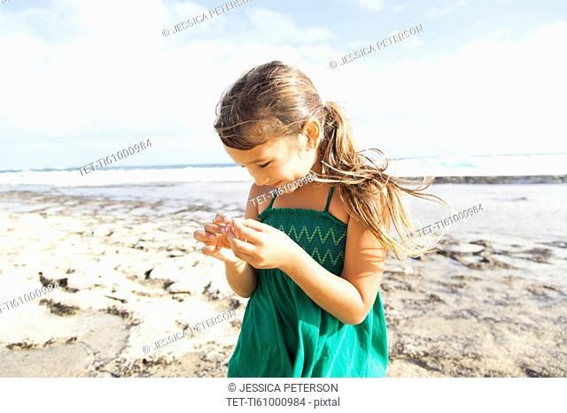 Girl (6-7) playing on beach