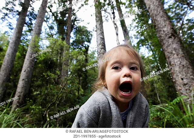 A girl screams in the forest