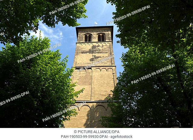 30 April 2019, North Rhine-Westphalia, Duesseldorf: The bell tower of the church Alt St.Martin-St.Bonifatius The church Alt St