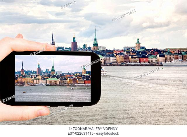 tourist taking photo panorama of Stockholm city