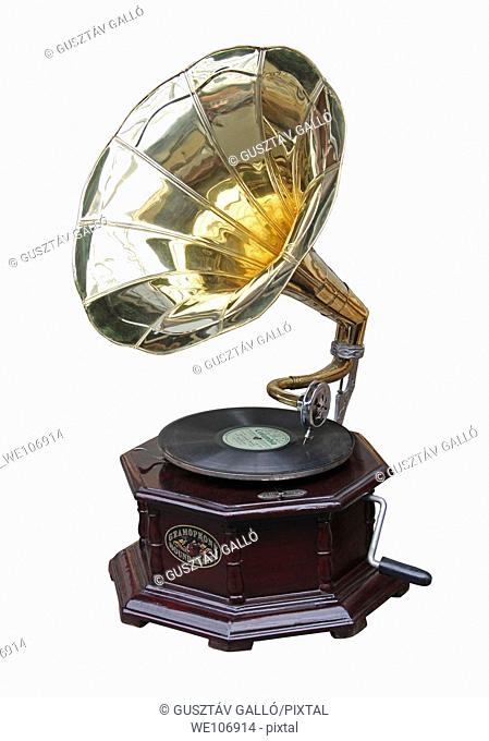 An old brass horn gramophone and record