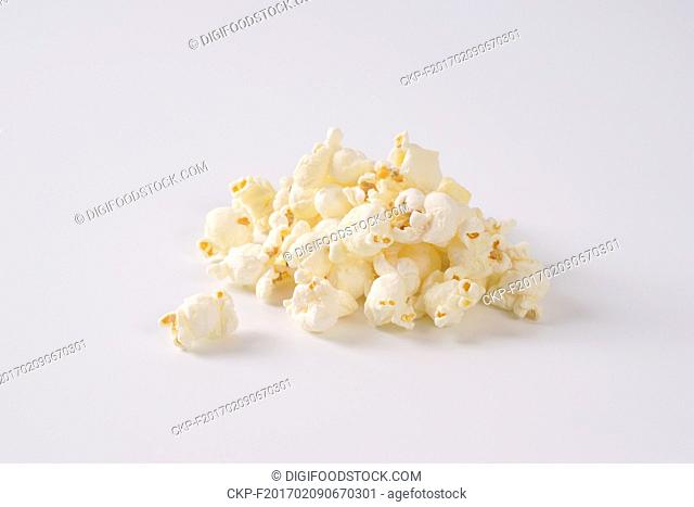 handful of fresh popcorn on white background