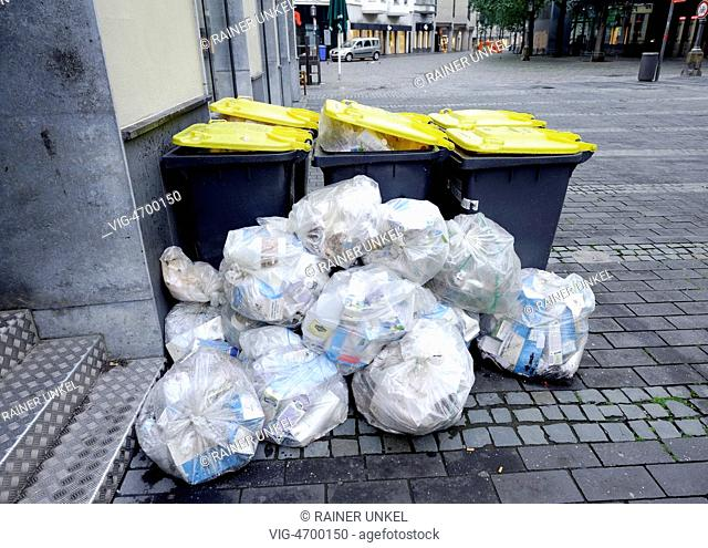 DEU , GERMANY : Yellow Bags are waiting for collection in Bonn - Bonn, Northrhine-, Germany, 05/08/2014