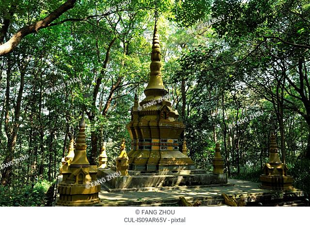 Pagoda in woods, in shadow of trees, Hangzhou, China