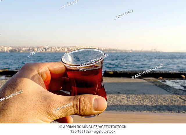 Hanging a cup of turkish tea in Istanbul city, Turkey