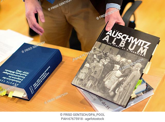 An edition of the 'Auschwitz Album' lies on a table on another day of trial against defendant Reinhold Hanning in Detmold, Germany, 22 April 2016