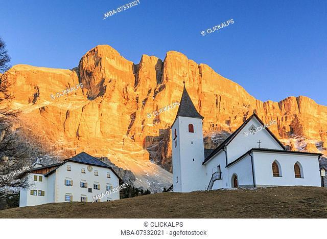 Italy, Trentino Alto Adige, Sudtirol, the church al Sas dla Crusc, in the background Sas dla Crusc mountain at sunset