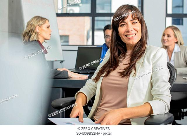 Businessman and businesswoman at meeting in office