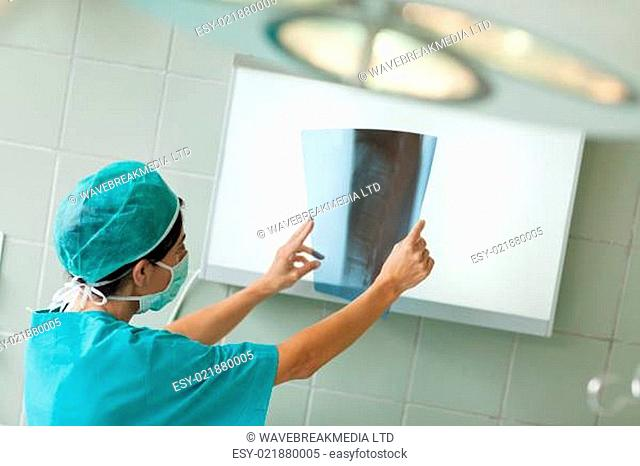 Surgeon looking at a radiography in a surgical room