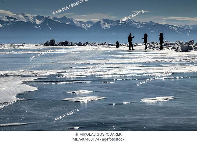 Asia, Russia, Siberia, Buryatia, Irkutsk Oblast, Lake Baikal, people walking on the ice