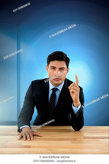 Businessman working on desk with blue light source