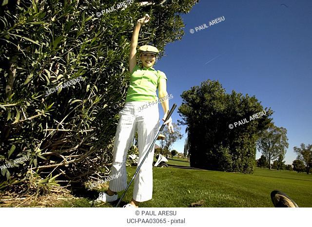 Cheering female golfer