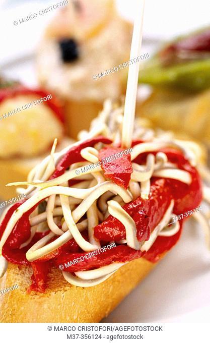 Tapa: montadito o pincho de gulas y piquillos / Tapa: succedaneous of eel and Piquillo peppers