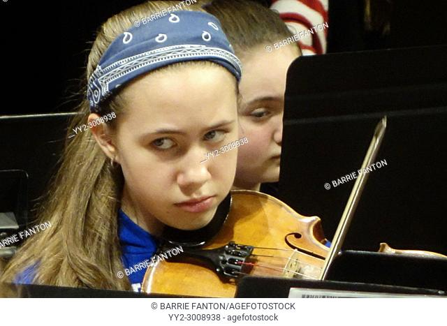 Students Preparing to Play in Middle School Orchestra, Wellsville, New York, USA