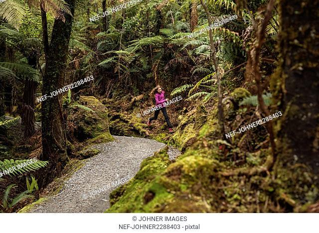 Girl running through forest