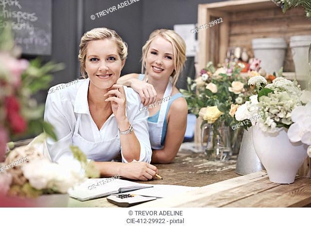Portrait smiling florists in flower shop