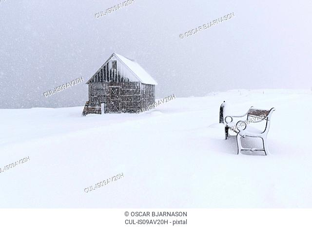 Snow covered shed and park bench, Seltjarnarnes, Iceland