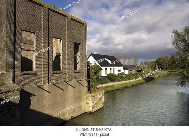 Ruined pumping station Rijkse Sluis near the dutch village Alphen