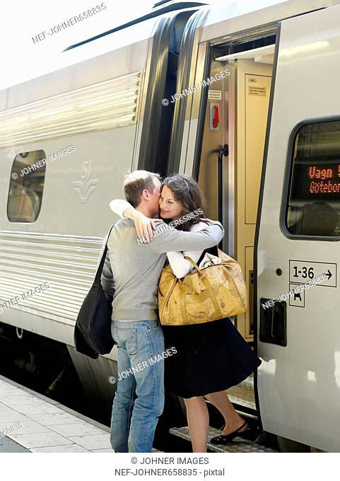 A young couple says goodbye on a train station, Sweden