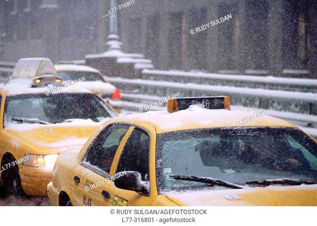 Yellow taxis on Park Avenue in snow storm. New York City, USA