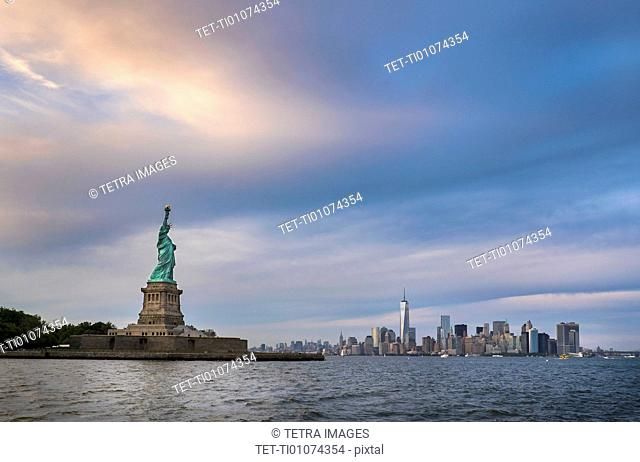Statue of Liberty with city skyline in background