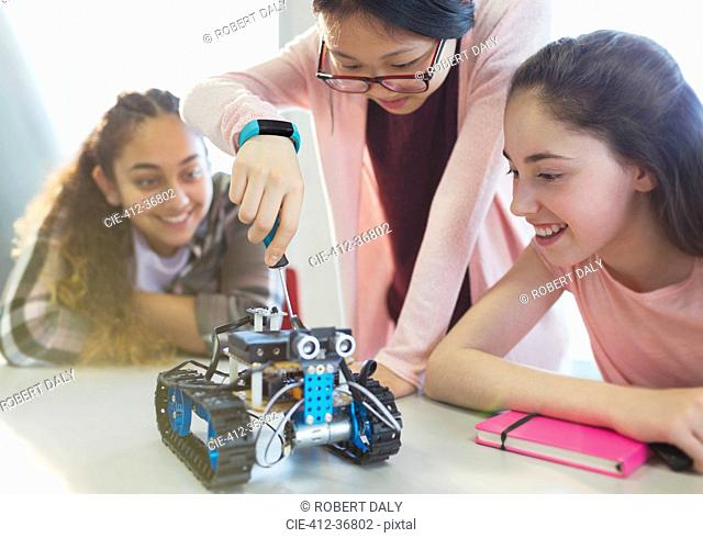 Girl students assembling robotics in classroom