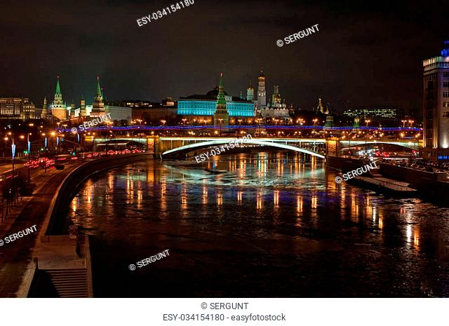 The Moscow Kremlin at night. View of the Moscow Kremlin and the Bolshoy Kamenny bridge at night